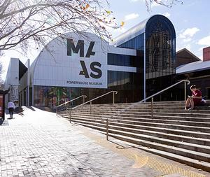 The Powerhouse Museum from outside, with a wide staircase leading to the front courtyard
